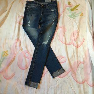 AG distressed step hem legging ankle jeans